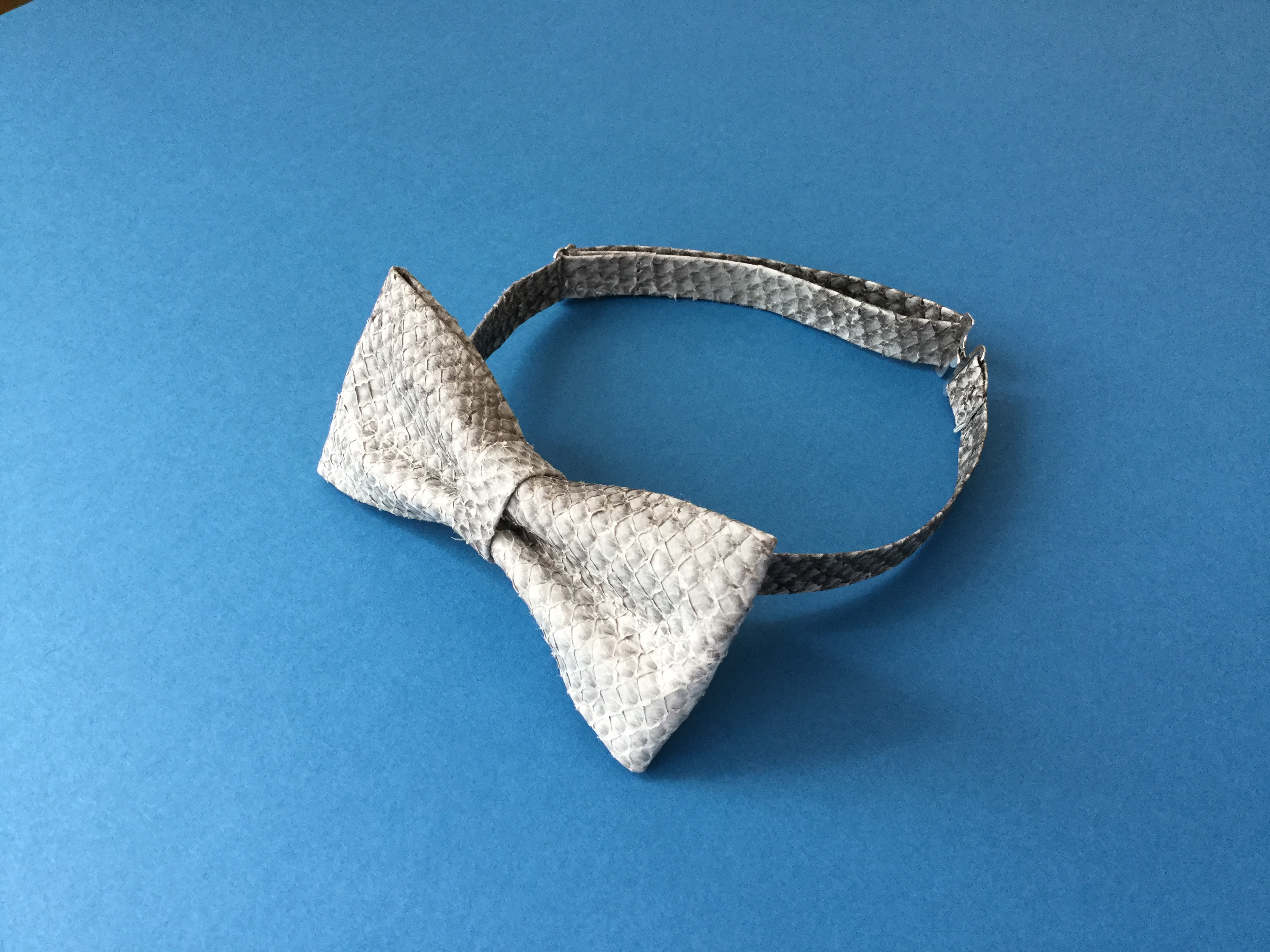 A bow tie from salmon leather