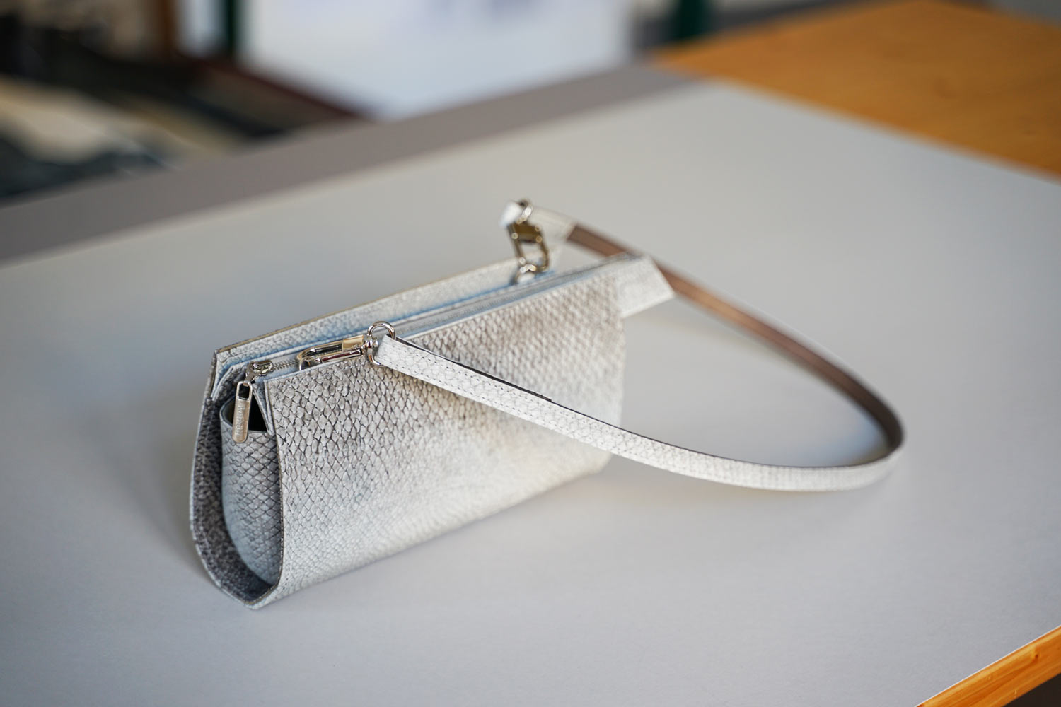 Small handbag made of natural gray salmon leather